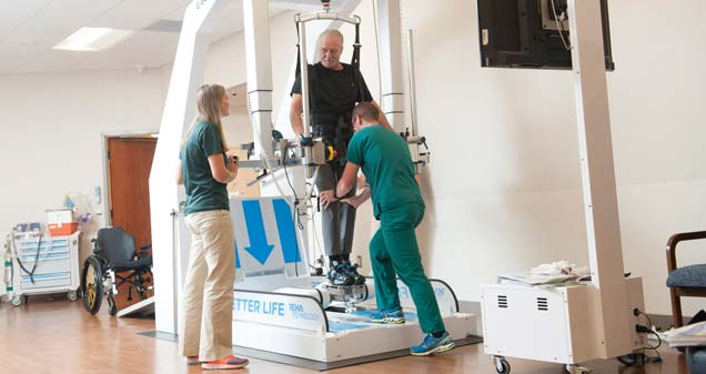 Ted Murray uses the G-EO machine with the help of physical therapists.